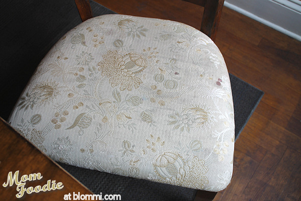 worn stained fabric on dining chairs