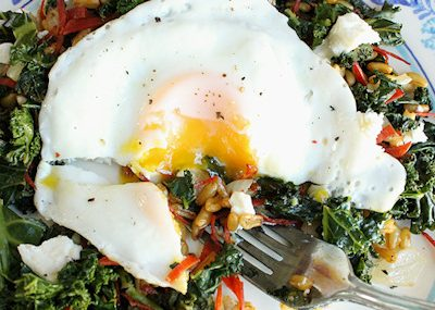 Kale Saute topped with Egg and Goat Cheese