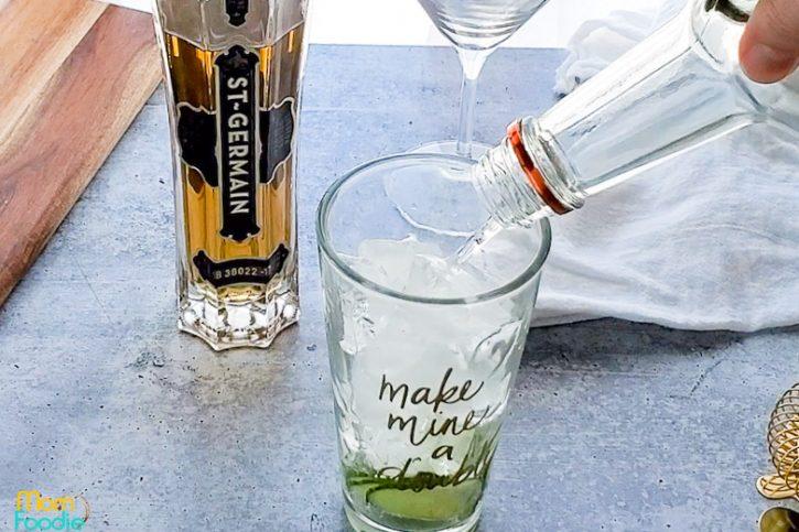 pour vodka into cocktail shaker