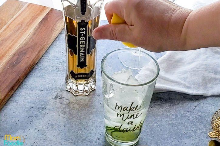 squeeze fresh lemon into mixing glass