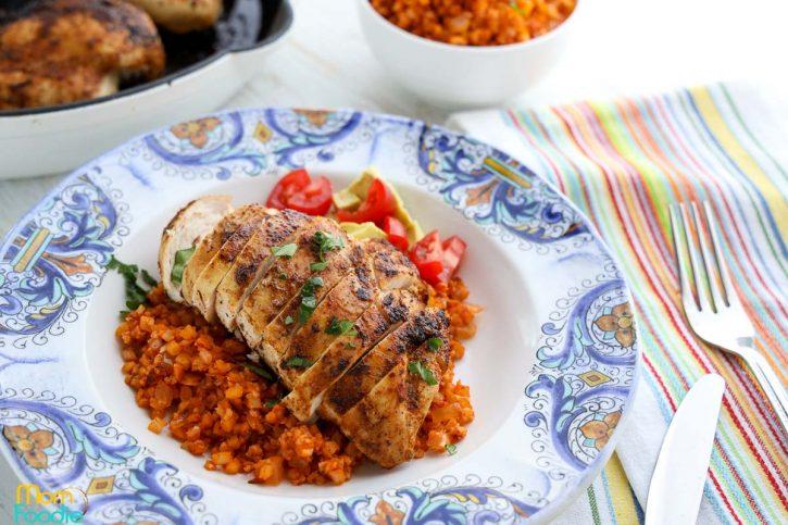 sliced Cajun chicken breasts over cauliflower rice