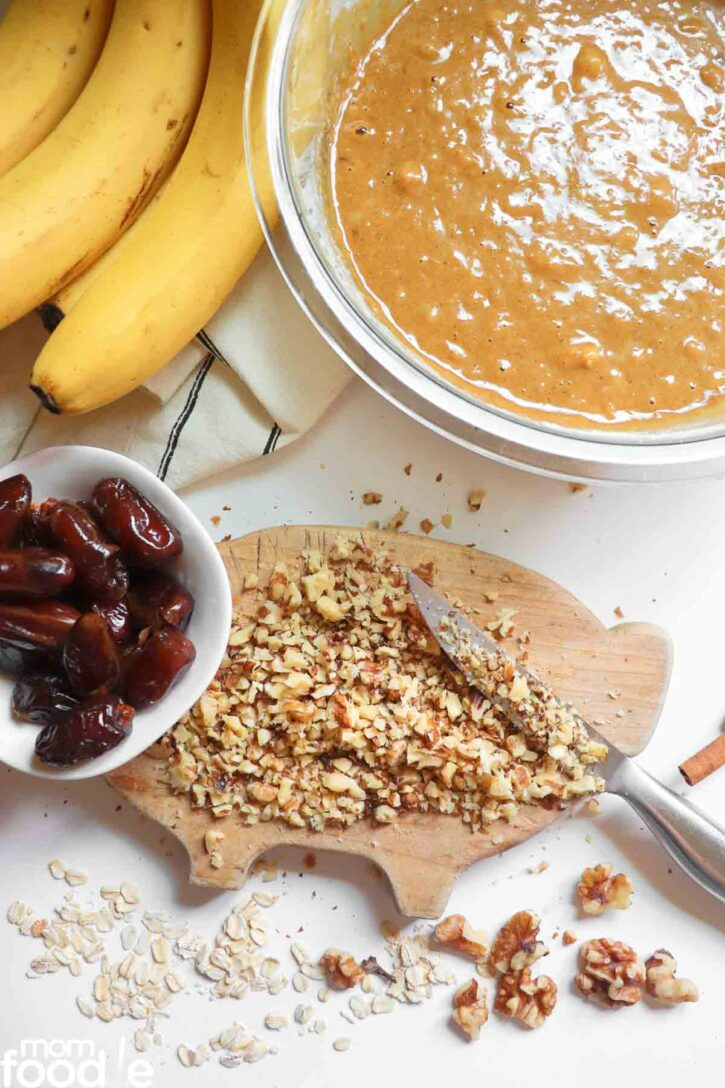chopping nuts on cutting board.