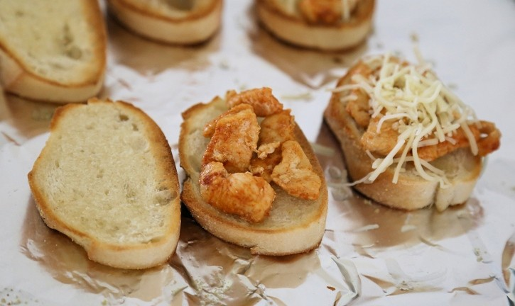 Cajun Chicken Cheese Toasts adding toppings