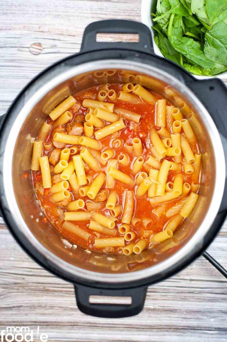 Pasta added to the kielbasa broth mixture.