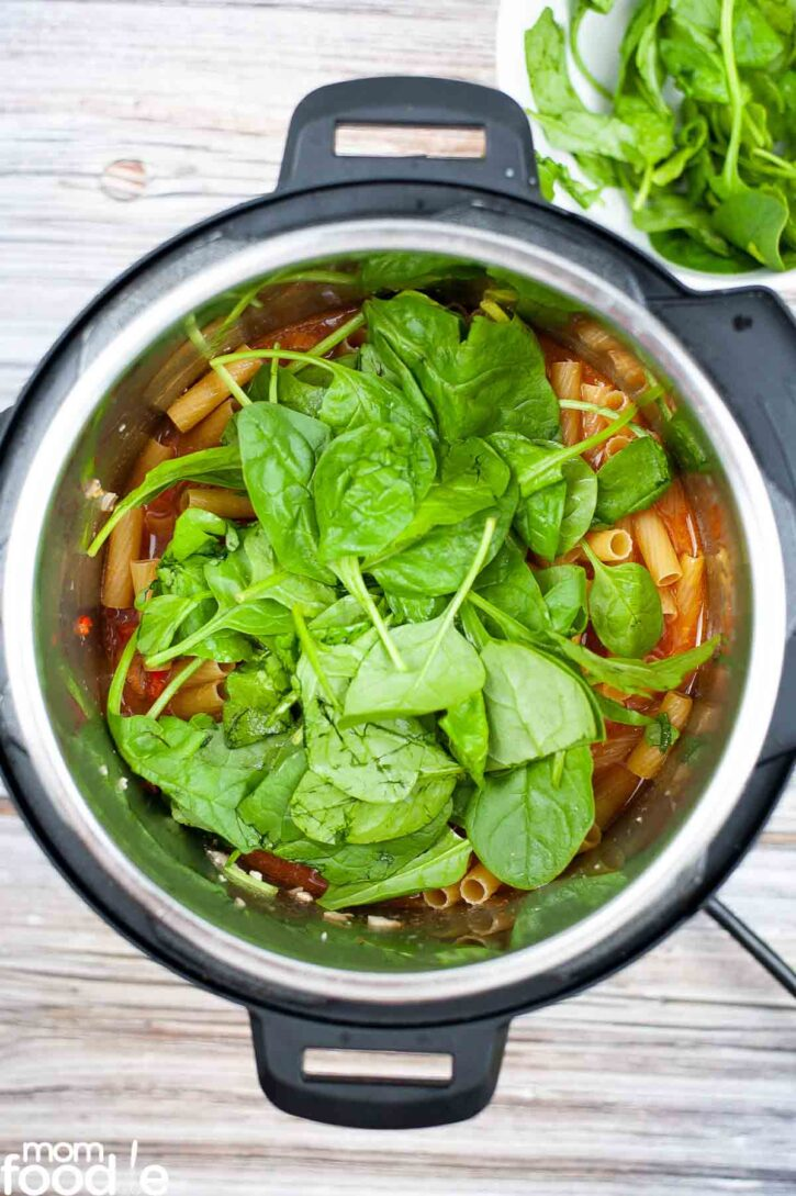 Spinach added to the pressure cooker.