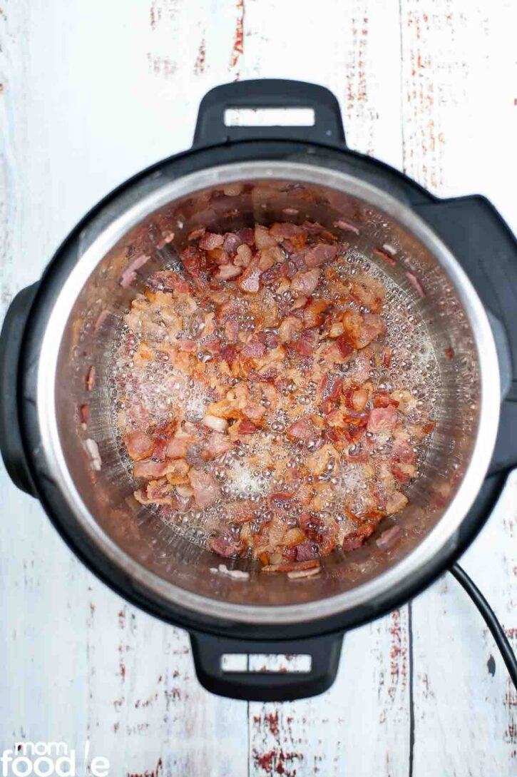 Frying bacon bits in Instant Pot on saute function.