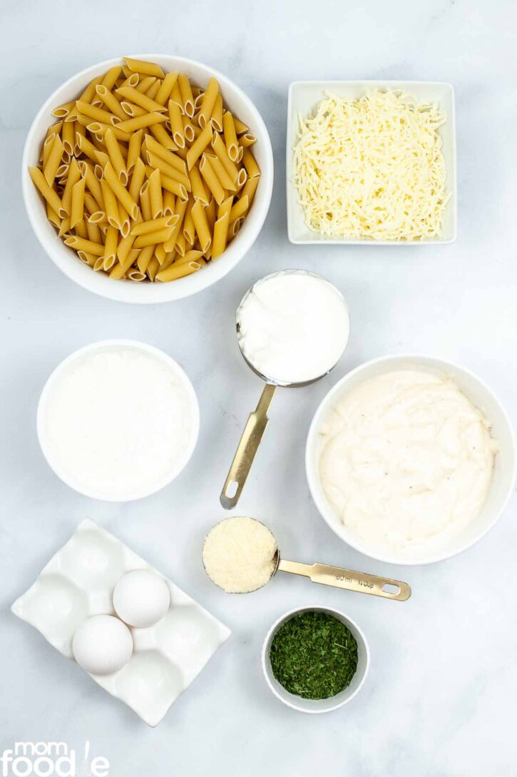 Ingredients for baked ziti with alfredo sauce.