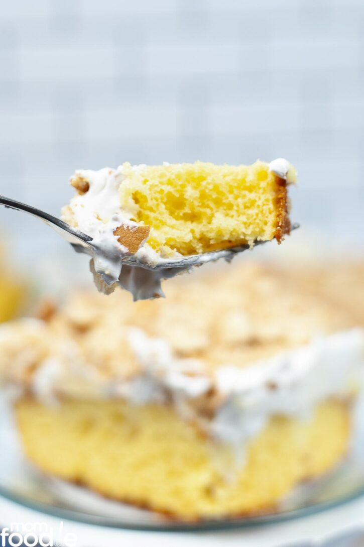 Bite of the banana pudding poke cake on fork.