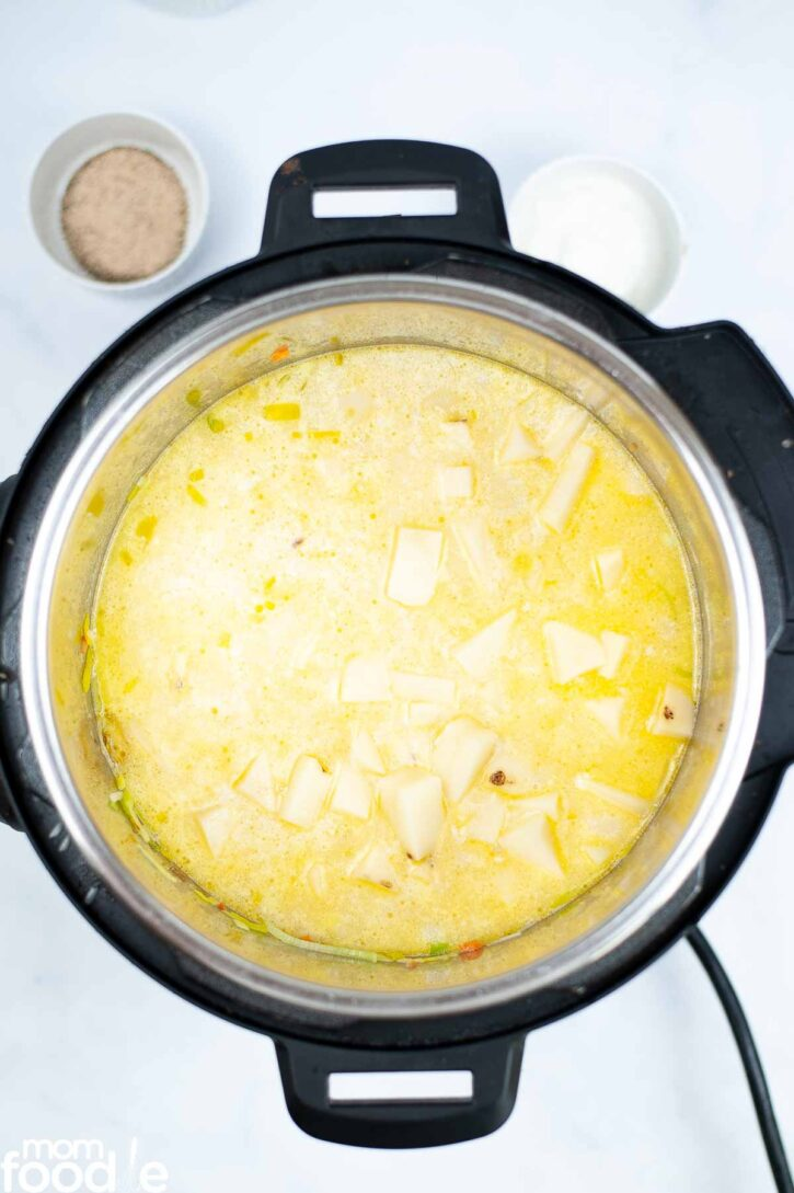 Broth, cream and potatoes added to the pressure cooker.