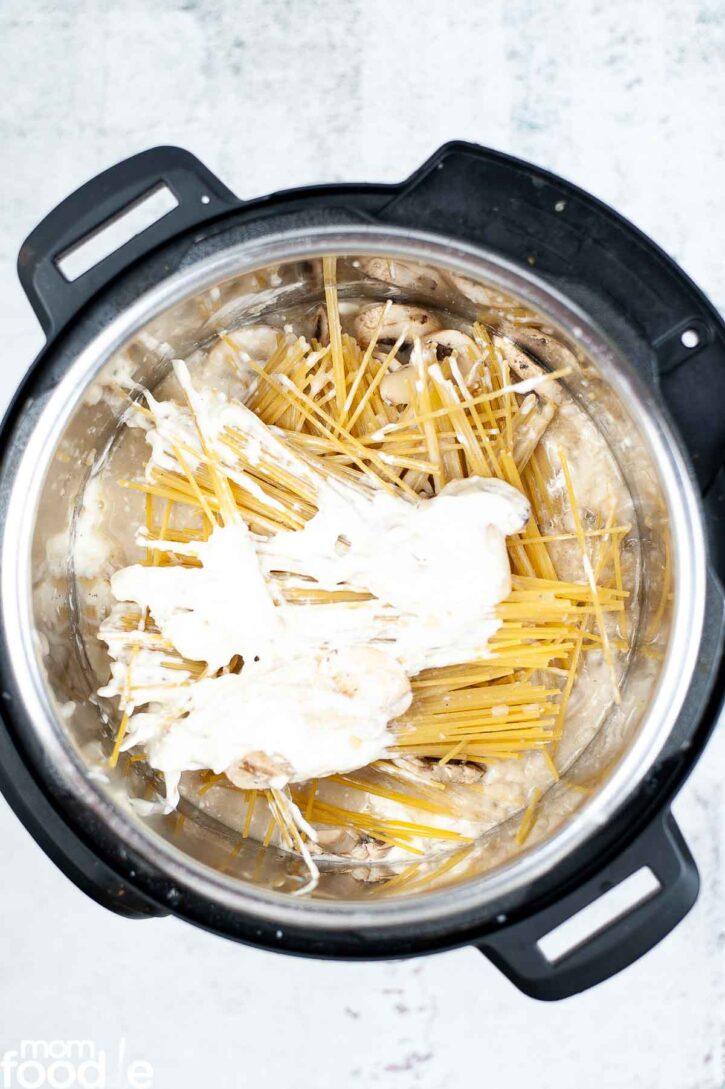 adding mushrooms, pasta, soup and sour cream.