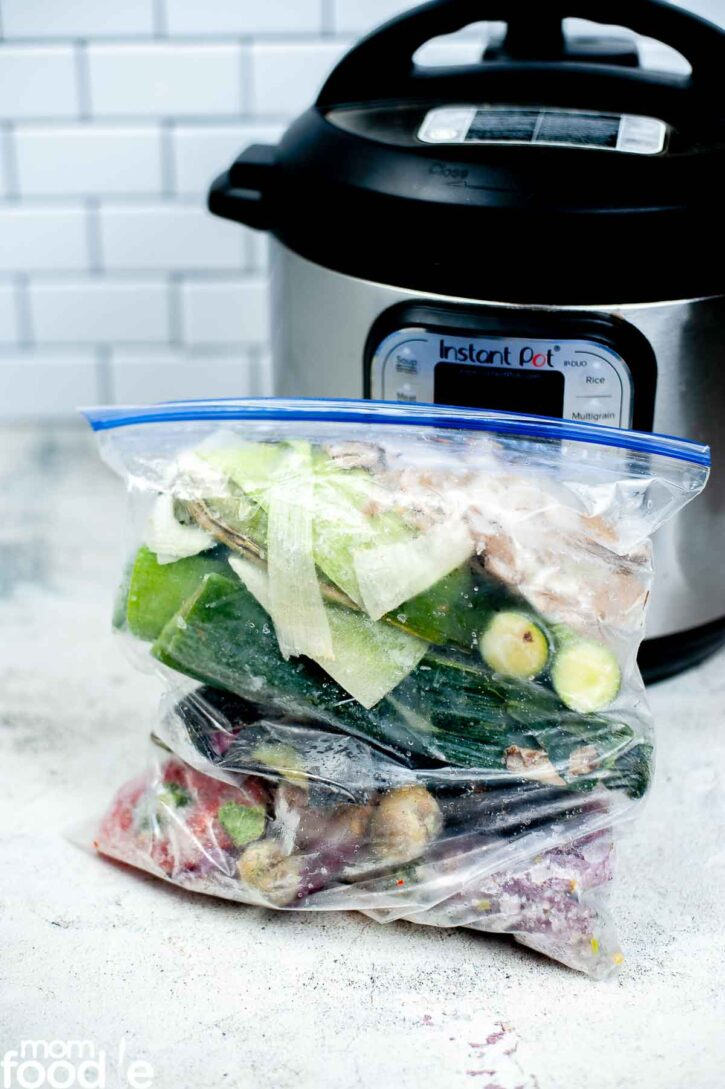 vegetables for soup stock in front of Instant Pot.