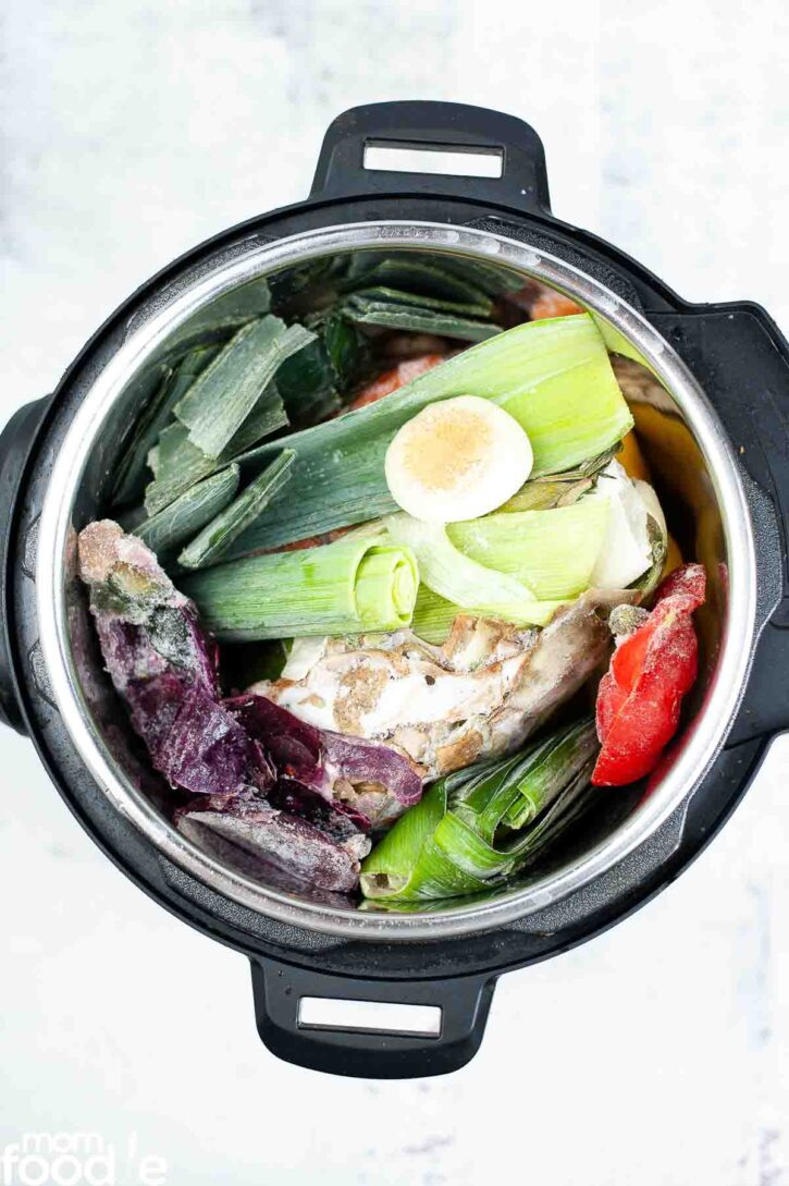 vegetables in Instant pot ready to make broth.