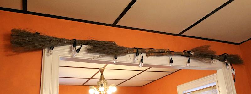 Fall Garland adding Cinnamon Brooms