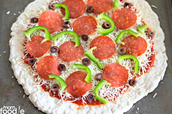 Favorite toppings added to the unbaked crust.