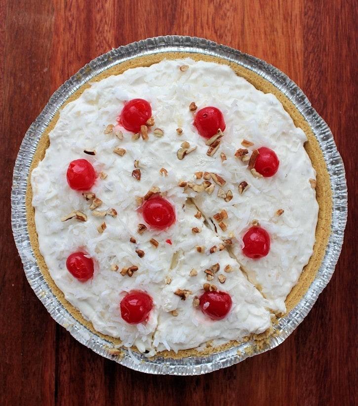 recipe million dollar pie in tin with slice ready to serve