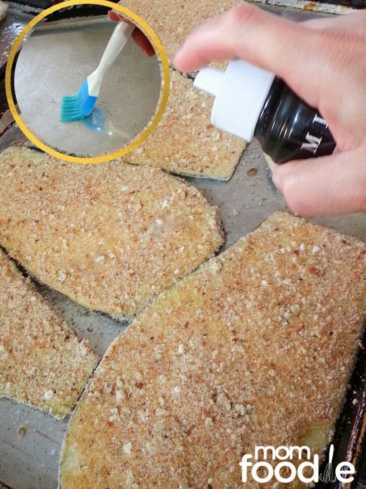 Prepping breaded eggplant for baking