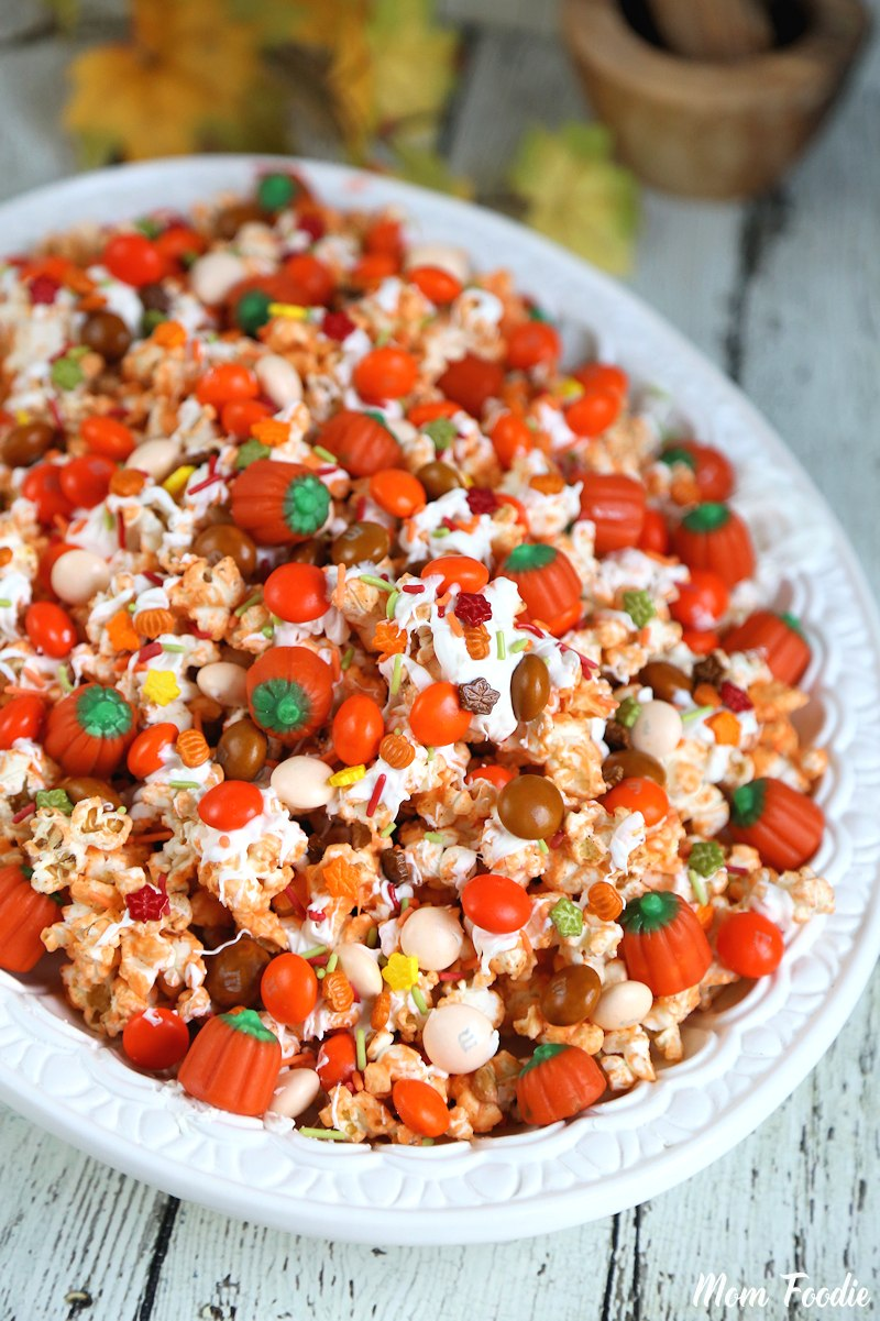 Pumpkin Spice White Chocolate Popcorn Mix via Mom Foodie