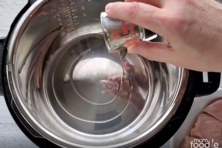 adding oil to the pot.