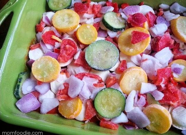 adding vegetables to the chicken ravioli bake