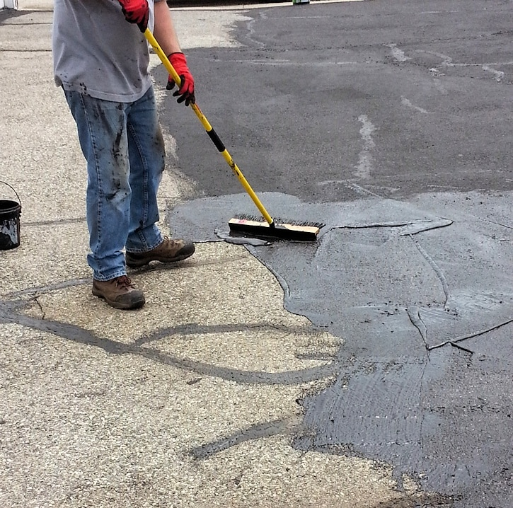 applying blacktop sealer
