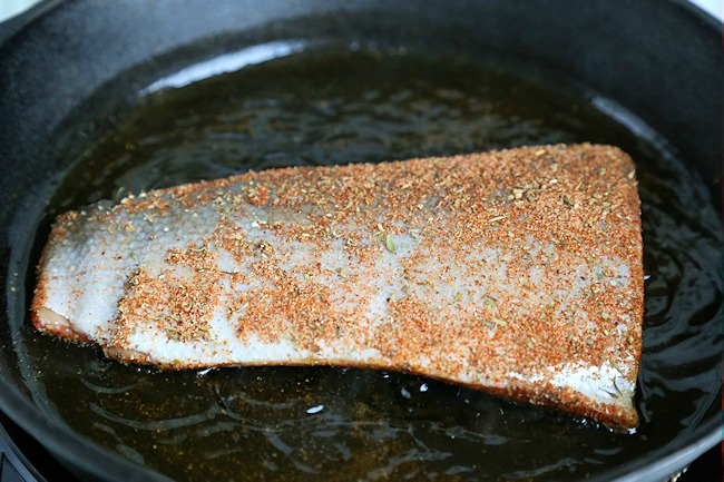blackened salmon cooking