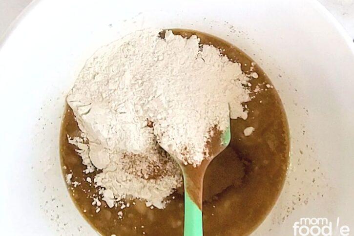 Add dry ingredients: flour baking soda cinnamon to the wet ingredient mixture.