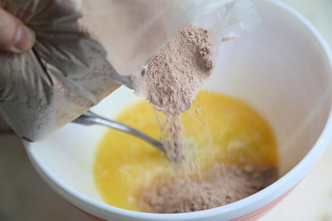 red velvet cake mix added to bowl
