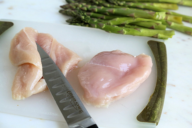 slicing chicken to stuff
