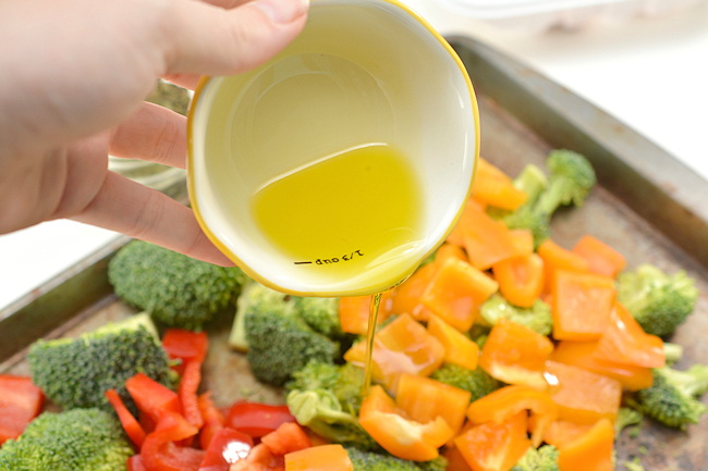 tossing vegetables with oil